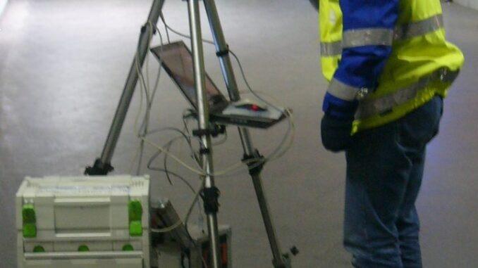Vermessungstechniker bei der Arbeit